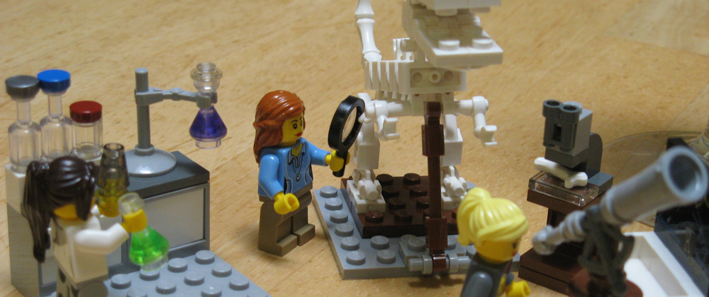 Lego figures of women doing science
